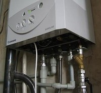 Image: wall mounted gas boiler.